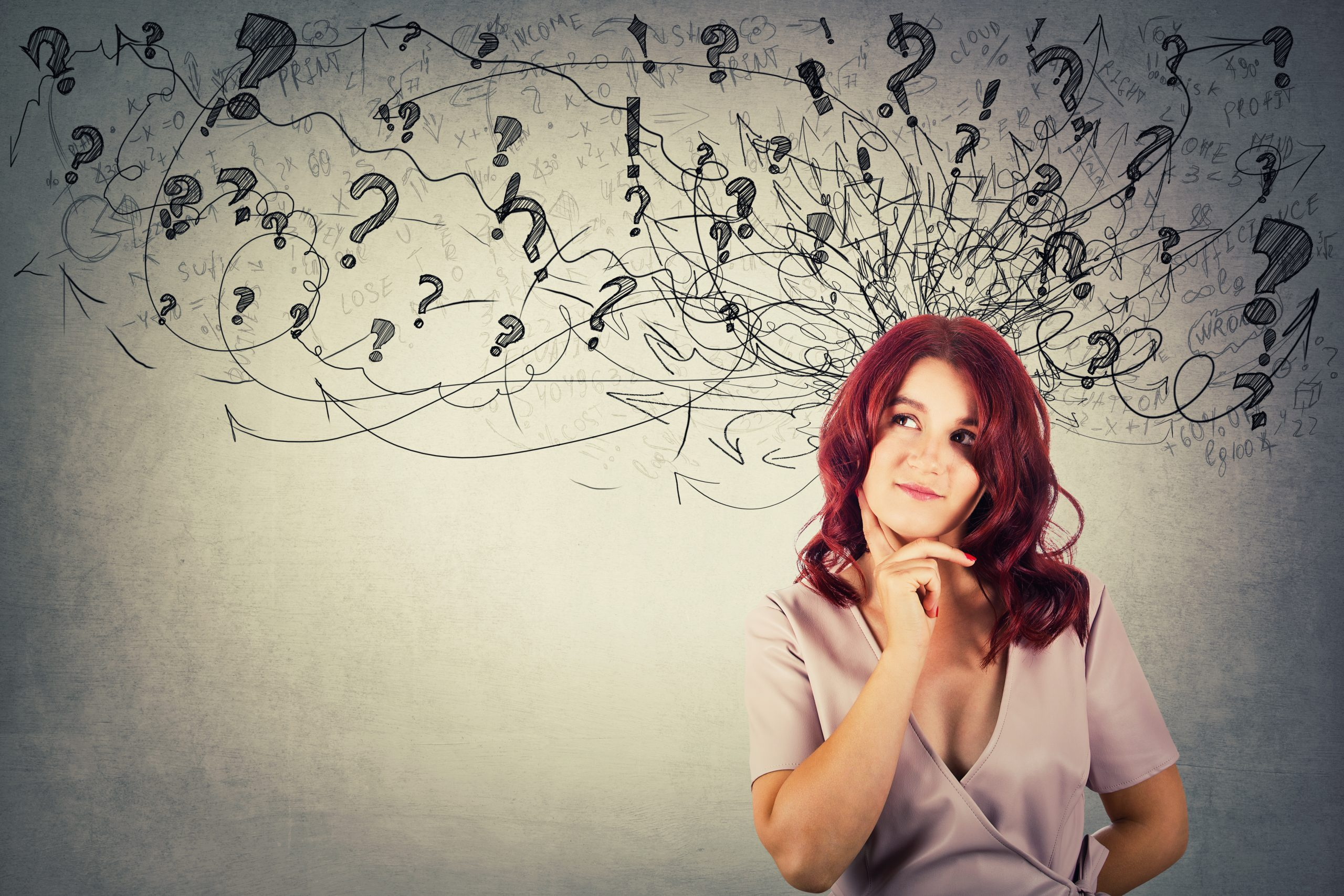 Young redhead pensive woman having questions holding hand under chin thoughtful looking at arrows and mess going out of head.